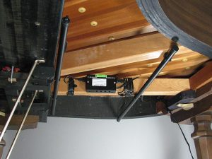Photo of a dehumidifier installed in a baby grand.