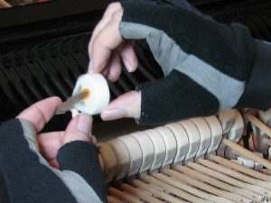 Photo of piano technician softening the felts.