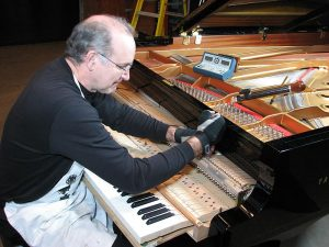 Tim Hollis, Registered Piano Technician in Panama City, Florida.