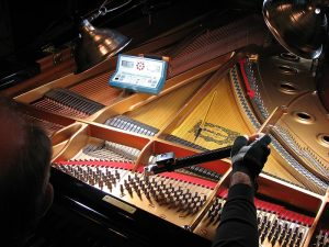 Photo - tuning a piano